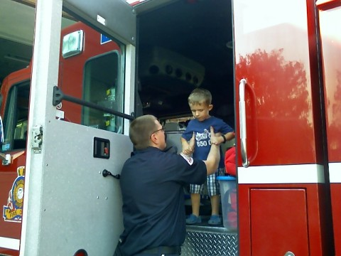 A fireman helping him out of the Rescue Truck