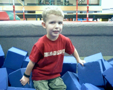 In the foam pit!!!  (If you look close at his hands you can tell he's hanging on for dear life!)