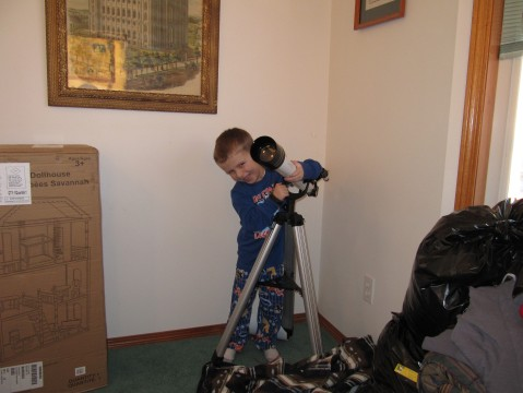 Russell hugging his telescope